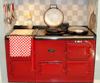 The Kitchen with a striking red Aga Stove.