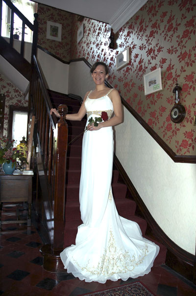 A bride descending the stairs at the Old Vicarage St Ives